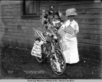 Mrs. Al White and her bike, Valdez, Alaska, July 4, [19]11.
