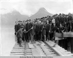 Judge R.A. Gunnison driving the first (a copper) spike in the laying of the first rails of the...