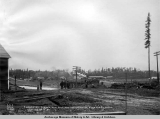 Anchorage, Alaska, new depot and freight house from the r[ailwa]y yards, looking up C St.