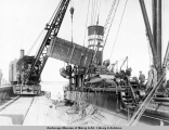 Unloading Panama freight from S.S. Turret Crown at Anchorage, Alaska.