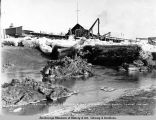 Mouth of Ship Creek and dock no. 1, Anchorage, Alaska, take[n] at low tide.