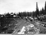 Laying steel in mile 286-288, Aug. 16, 1921.