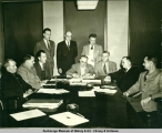 Signing for Anchorage library bonds, 1953.