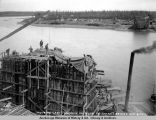 Pouring last concrete on pier 12, Tanana bridge, Sep. 8, 1922.