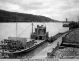 A.E.C. river boat Matanuska transferring gravel from Nenana dock to north pier no. 12 of Tanana...