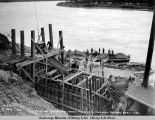Pouring concrete, north pier no. 12, Tanana bridge, Sep. 1, 1922.