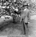 James J. Delaney and his matured apple trees.
