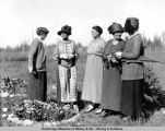 Mrs. Harding inspects pansy bed at Montana - mile 260.