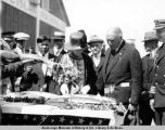 President Harding inspecting salmon at Metlakatla, with Mrs. Harding.