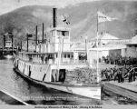 Passengers disembarking at Dawson, Y[ukon] T[erritory] from White Pass steamer.