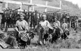 Native Alaskan girls drying salmon.