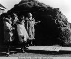 Visitors look over a sod igloo at Pt. Barrow.