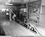 Bowling in rec hall at Good News Bay Mining Co.