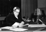 Mildred R. Hermann signing the Alaska State Constitution.