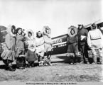 Villagers standing by a Wien Alaska Airlines plane in Point Hope, Alaska.