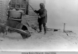 Diomede Island: chipping ice after blizzard, 1916.