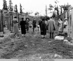 Tourists at dog kennels built by CCC. Mt. McKinley, Alaska.