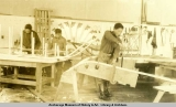 Eskimo boys at Gov't school at Eklutna making sleds & snowshoes.