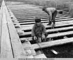 C.C.C. enrollees salvaging lumber for building board walk. St. Michael, Alaska.