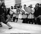 King Island Natives singing and beating drums, Federal Building cornerstone ceremony. Nome, Alaska.
