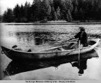 Klawock. Mrs. Tom Adams in red cedar dugout canoe. 1938.