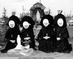 Sisters of Providence by shrine on hospital grounds.