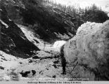 View, showing depth of snow in canyon. Mile 269-271. A[laska] N[orthern] R[ail]road. May 23 - 1920.
