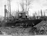 May 18 - 1920. Excavating foundation for pier 35, Susitna River bridge, before the ice run.