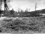 May 21 - 1920. Excavating for pier 35, Susitna River bridge, after the ice run.