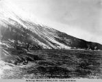 Looking south from m[ile] 85 to 82 showing trestle and snowslide mountain's [sic]. A.E.C....
