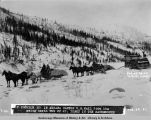 Mile 351 in Nenana Canyon. U.S. Mail 7000 lbs. going north. Feb. 22, [19]21. Dink[e]y in the...