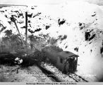 3/13-[19]18. Station men at work in rock cut. Mile 87. Turnagain Arm. F. Daniels, contractor.