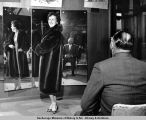 Margo Britch models a beaver coat.