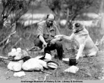 Fritz Nyberg and dog at campsite, Mt. McKinley Park