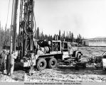 Drilling a water well at the Prospect Camp site.