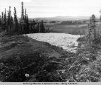 Station 1242-88. The road cut on south bank of Hess Creek. Insulation is batts of styrofoam.