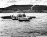 Ferry crossing the Tazlina River August 1975 as they build the suspension bridge for the pipeline.