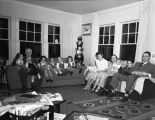 Bob Reeve and Dr. Jackson families in Reeve home on Thanksgiving Day, 1947.