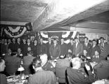 American Legion Jack Henry Post pose w[ith] Gen. Eisenhower at the banquet.