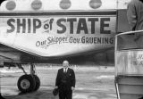 Gov[ernor] Gruening front of Ship of State at Juneau, AK. on 3-26-49 when group went to...