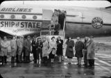 Group in front of Ship of State of Alaska Airlines on trip to Washington, [in] Juneau, AK.