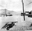 Looking toward the bay down Keystone Ave. near the cor[ner] of Hobert St., Valdez, Feb. [18]99.