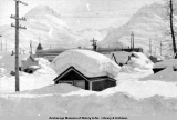 Snow on roof of house, Valdez, Alaska.