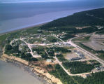 Kenai, Alaska, School in right fore. End of Municipal airport shows at right.
