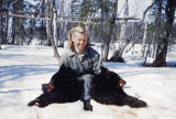 Vi Redington posing with two bears.