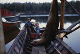 Tim and Keith Redington with a sea lion in motor boat.