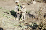 Tim and Keith Redington holding turnips.