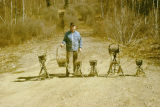 Joe Redington Sr. behind six baskets made by Joe Redington Jr.
