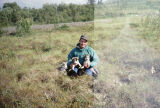 Joe Redington Sr. with pups in Unalakleet.