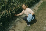 Vi Redington at the Experimental Farm, in front of corn.
